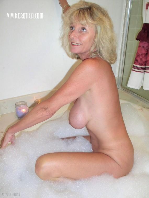 Busty mom, Susan is taking a bubble bath.