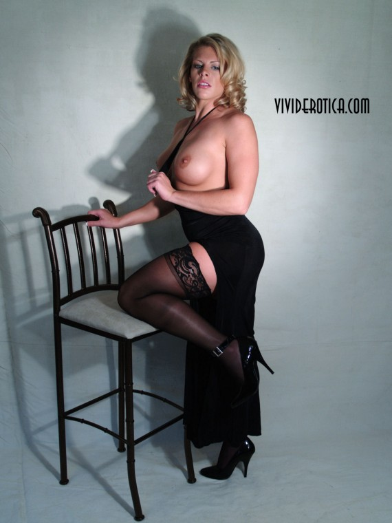 High heeled, big blond beauty, Tara, doing pinup.