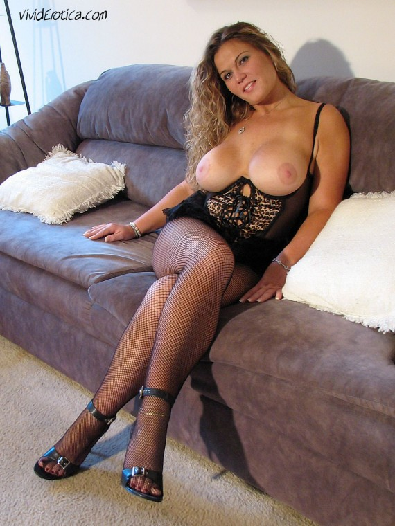 Jessica, the hot blonde with big boobs is dressed in lingerie, fishnets and high heels